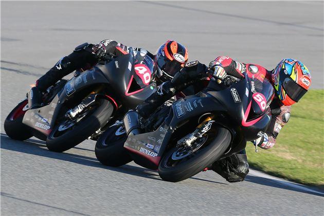 Latus Motors Racing/Castrol Triumph's Bobby Fong (50) leads Jason DiSalvo (40) into a corner at Daytona.